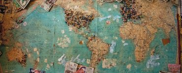 World map with money on it describing geo targeting wasted dollars on wrong Google Ads targeting.
