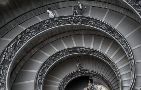 Spiraling court stairs with people that have left the deliberation post ppc fraud trial.