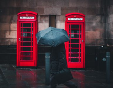 Two red British telephone booths.