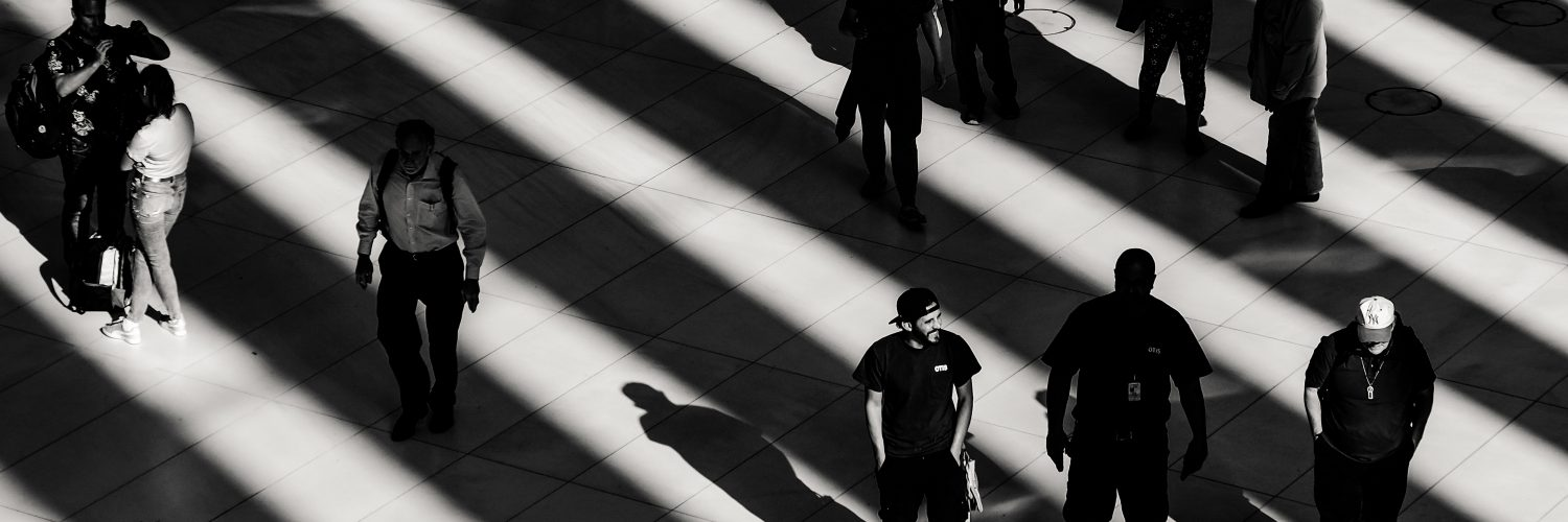 People walking across floor, creating shadows.