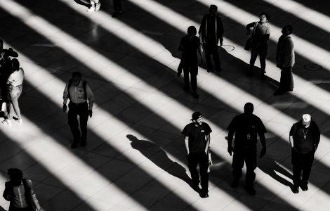 People walking across floor, creating shadows.