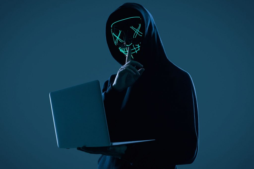 cyber criminal committing digital fraud