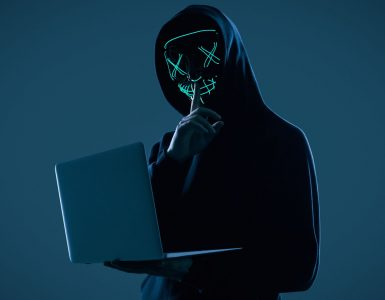 cyber criminal committing digital fraud